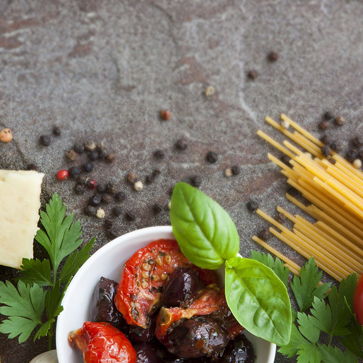 Italian food background, with vine tomatoes, basil, spaghetti, m